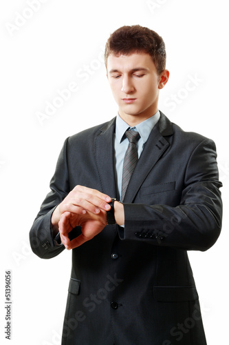 man pointing at his watch