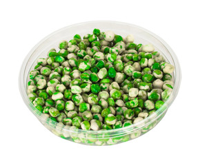 Spicy dried wasabi peas in clear bowl