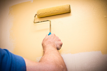 Hand painting an interior wall