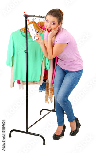 Young girl buying clothes isolated on white