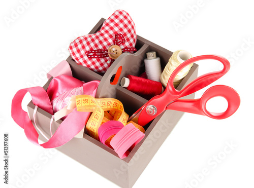 Box with the materials at hand sewing isolated on white
