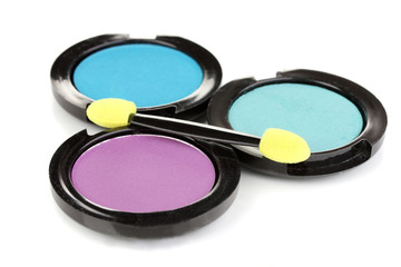 Bright eye shadows and sponge brushes for foundation isolated