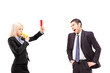 Woman in business suit showing a red card to an angry man in a s