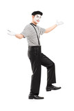 Full length portrait of a mime dancer gesturing with hands