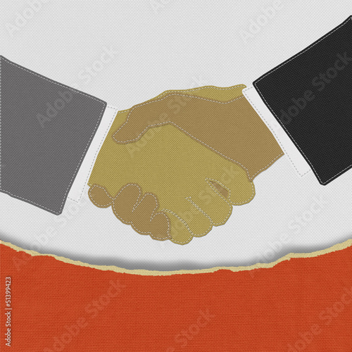 Businessmen shaking hands with stitch style on fabric background