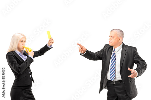 Professional woman showing a yellow card to her boss