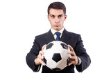 Young businessman with football on white