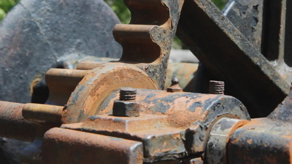 Rusty gears turning. Two shots.