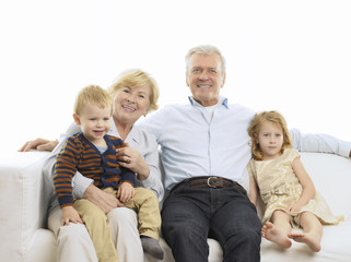 Portrait Of Grandparents And Grandchildren On Sofa