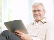 Senior man reading an e-book