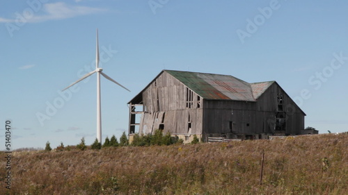 Modern windmill. Old barn. Ontario.