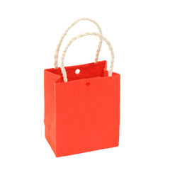 Small orange paper bag on isolated white background