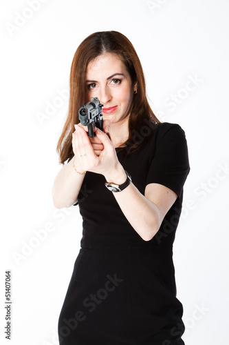 Young and beautiful woman with a gun