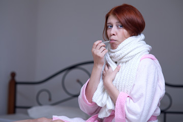 A woman with a thermometer