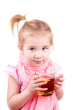 Sick little girl with chickenpox drinking tea with lemon