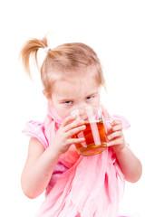 Sick little girl with chickenpox drinking tea with lemon