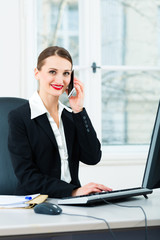 businesswoman in office sitting on the computer