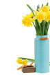 bouquet of daffodils in blue vase
