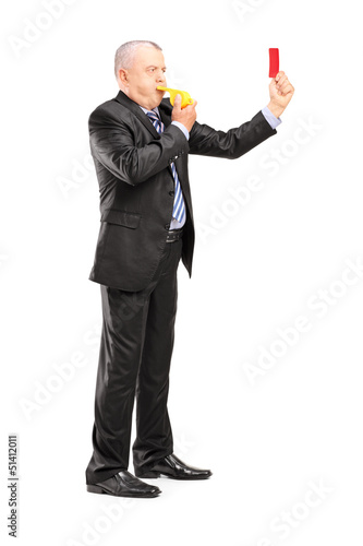 Full length portrait of a mature businessman blowing a whistle a