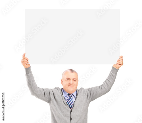 Mature gentleman sitting and holding a blank panel above his hea