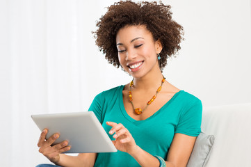 African Woman Looking At Digital Tablet