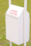 A German doggy rubbish toilet bin for dogs waste