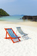 white sand beach, beach and two colorful tote beds by ocean