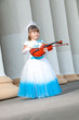 Violinist. Pretty girl in a smart dress with a violin