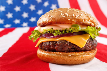 Juicy grilled hamburger on USA flag background