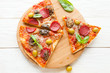 cut in ​​pizza with cheese, mushrooms and salami on board