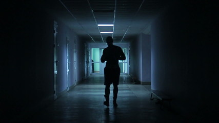 boxer walks down the hall before the fight