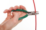Hand with metal nippers is cutting cable poster