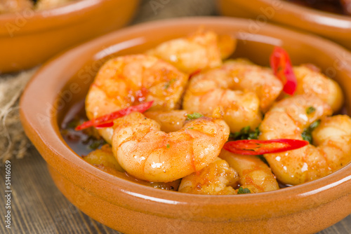 Gambas Pil Pil (Sizzling prawns with chili and garlic). Tapas.