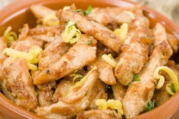 Pollo al limon con ajo (Chicken with lemon and garlic). Tapas