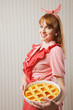 Beautiful woman holding italian pie.