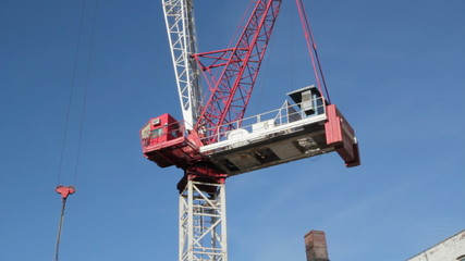 Red tower crane at construction site. Toronto.