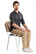 Young caucasian handsome man sitting on the chair