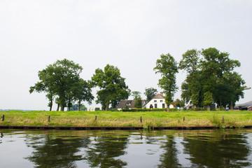 Dutch farmhouse near river
