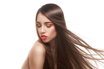 woman with long brown hairs and red lips