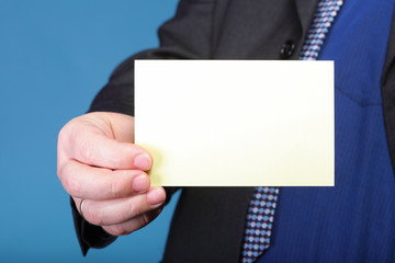 Close up of business note card in male hand
