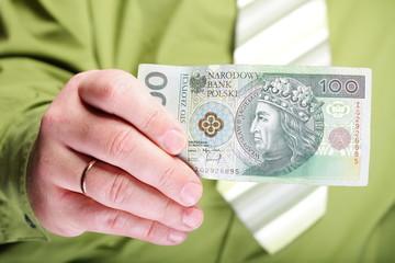 Businessman holding money 100 polish zloty