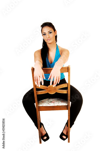 Girl sitting on chair.