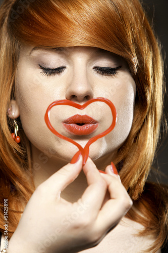 happy redhair girl with heart love symbol