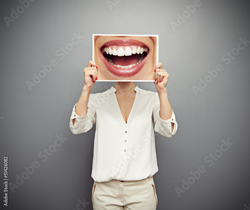 Poster woman holding picture with big smile