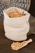 Beans in sack on wooden background