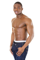 Happy well-built muscular black man in jeans