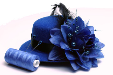 Blue hat and coil of threads
