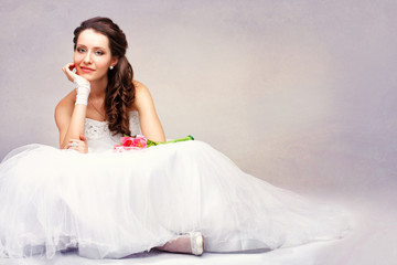 beautiful bride sitting on the floor
