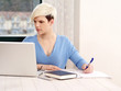 Pretty female working on laptop
