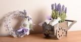 Decorative set with wicker wreath and wooden cart with Lavender.